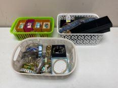 A tray of three baskets of bangles, bracelets,