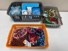 Three basket of costume jewellery, beaded necklaces,