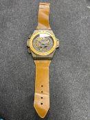 A wristwatch wall clock with strap