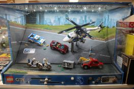 A Lego City 60138 and 60137 sets in shop display case