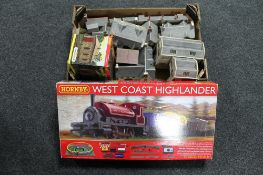 A boxed Hornby West Coast Highlander 00 gauge train set together with a further box of buildings