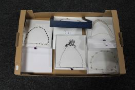 A box of five costume necklaces
