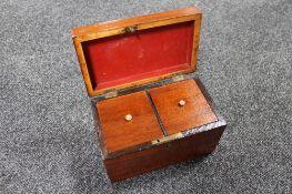 A Victorian mahogany tea caddy