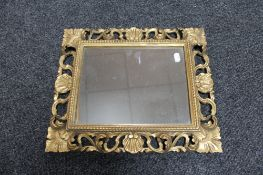 A Victorian decorative gilt framed mirror, height 42cm,