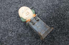 A cast iron Humpty Dumpty money box
