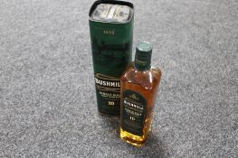 A bottle of Bushmills single malt Irish Whiskey aged 10 years,