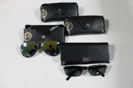 A box of four pairs of Rayban sunglasses and prescription sunglasses together with a pair of Hugo