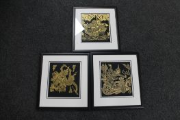 Three framed Indonesian fabric panels depicting warriors and gods