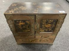 A Japanese Meiji period lacquered table cabinet