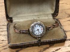 A lady's vintage 18ct gold diamond set cocktail watch on 9ct gold bracelet