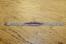 An 18ct white gold ruby and diamond set bracelet CONDITION REPORT: 38.2g.