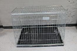 A folding metal dog cage width 97 cm