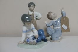 Three Nao figures; boy kneeling,