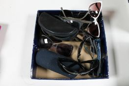A box of designer sunglasses and prescription glasses to include So-Cal and Company,