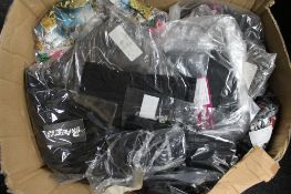 A box of Phaze petticoats and sleeveless tops