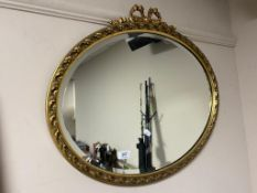 An ornate bevelled gilt framed mirror