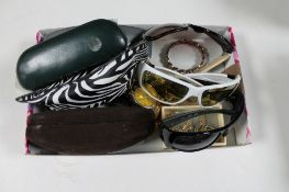 A box of costume jewellery, wristwatches,