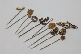 A collection of gold and other pins