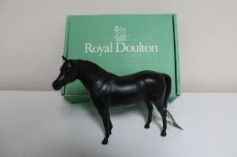 A boxed Royal Doulton horse in black matte finish