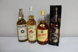 Four bottles of alcohol; Teacher's Scotch Whisky 26 fl. oz.