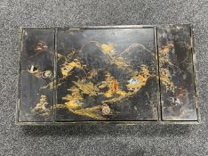 A Japanese lacquered and mother of pearl inlaid table box
