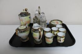 An ornate Japanese porcelain coffee set and a silver plated cruet