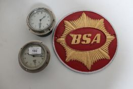 Two circular Smiths clocks and a BSA metal plaque CONDITION REPORT: The sign is a