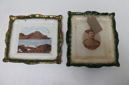 Two antique pottery plates depicting The Giant's Causeway and Baden Powell