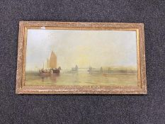 A gilt framed oil on board - figures in boats