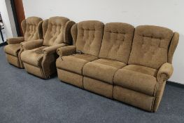 A three piece lounge suite in brown floral fabric