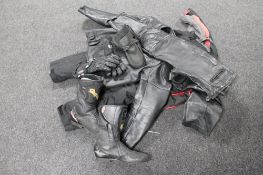 A box of motorcycle items, jacket,