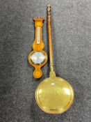 An inlaid mahogany cased barometer and a 19th century brass and copper warming pan