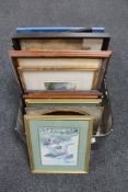 A luggage case containing framed pictures and prints