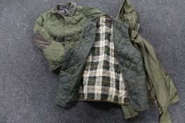 A Barbour quilted body warmer together with a Barbour quilted child's jacket and a Barbour shower