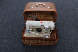 A cased 20th century Prinzess electric sewing machine (continental plug)