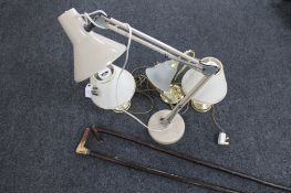 A metal angle poised lamp and three further lamps
