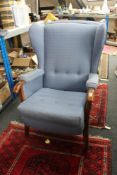 Two mid 20th century blue upholstered armchairs