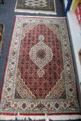 A Tabriz design rug,