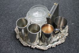 A silver plated tray, pewter tankards,