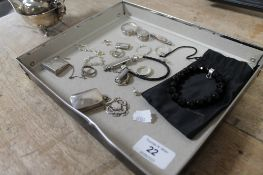 A collection of silver and white metal jewellery, miniature pill boxes,