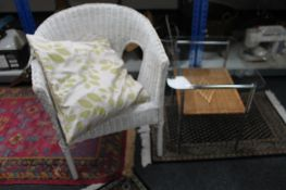A wicker armchair and a metal and wicker side table