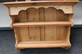 A vintage pine plate rack