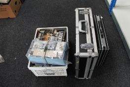 Two metal bound cases together with a box containing cassette tapes,