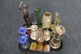 A brass table lamp together with brass candlesticks,