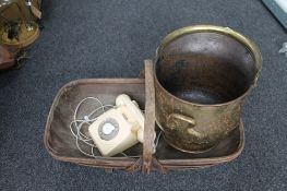 A brass coal helmet together with a vintage trug and an old telephone