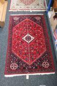A Persian Khamseh rug,
