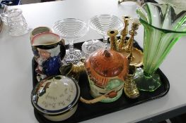 A tray of brass candlesticks, cocktail glasses,