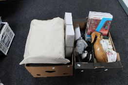 Two boxes containing headphones, wooden duck figure, Kodak carousels,