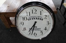 A reproduction wall clock - Guinness on draught