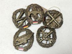 A collection of badges, German enamelled car badges etc.